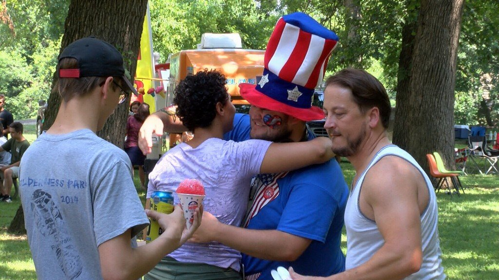 A Man Dressed As Uncle Sam Gives His Friend A Hug At Pittsburgs Lincoln Park