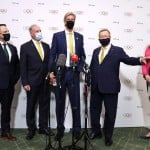 The Latest: Australia Olympic Chief, Leader In Spat