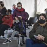 The Latest: Israel Reimposes Tighter Pandemic Restrictions