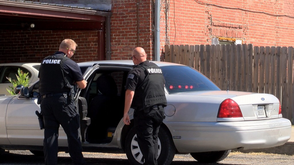 Baxter Springs Police Inspect A Police Vehicle