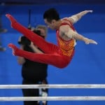 Olympics Latest: China's Zou Wins Gold On Parallel Bars