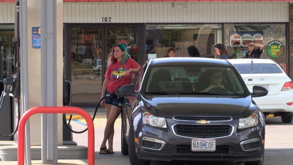 A Woman Fuels Up Her Car In Carl Junction