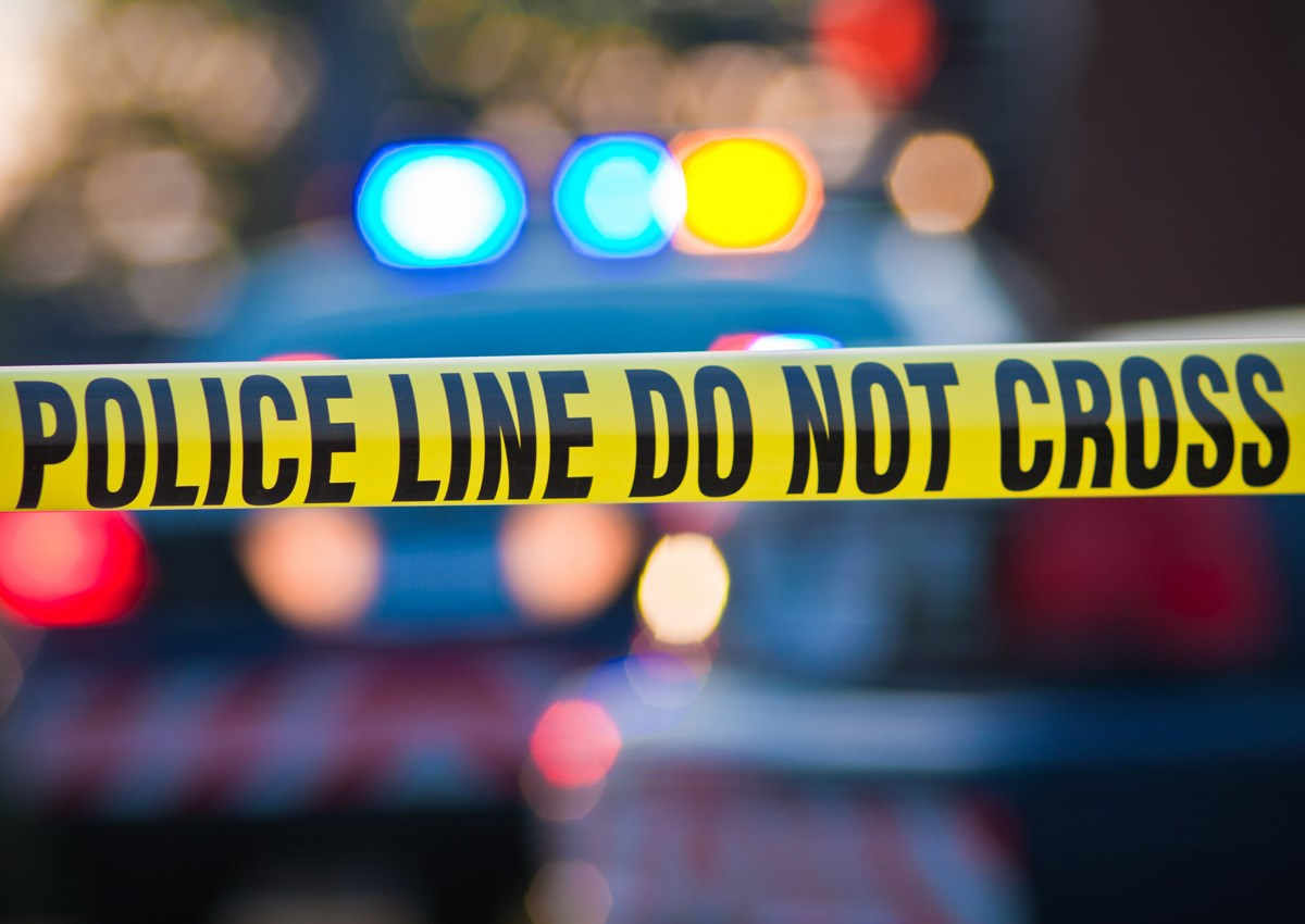 Suicide victim found behind a liquor store -