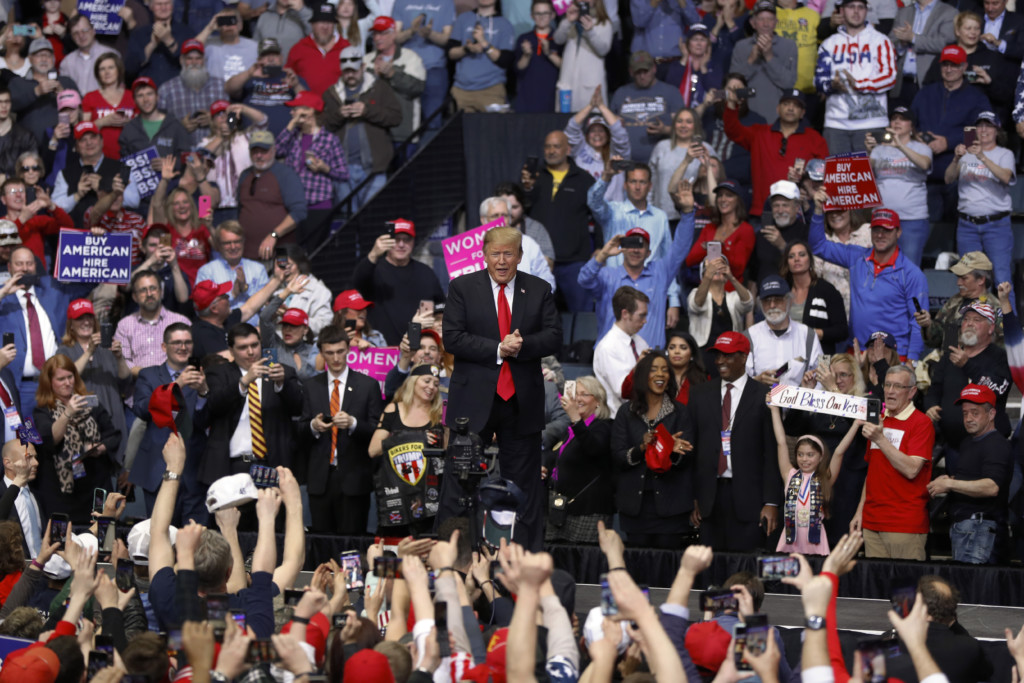trump blasts russia probe  calls  democrats radical  michigan rally
