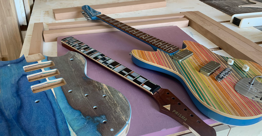 "A Local Artist Makes Guitars Out Of Recycled Skateboards, ""prisma Guitars"""