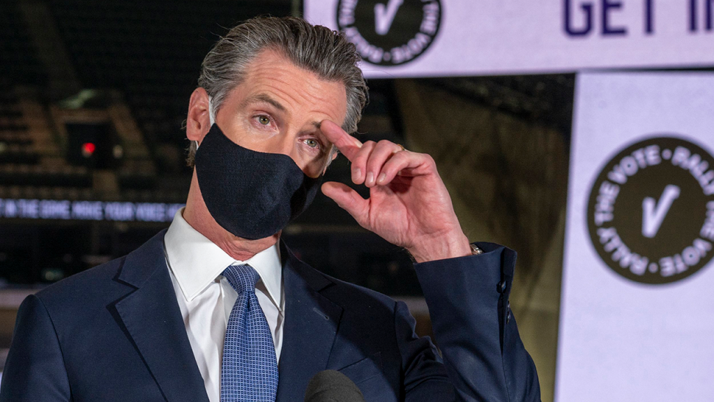 Newsom Scratches Head With Mask On