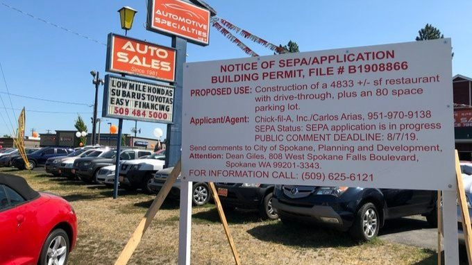A Chick-Fil-Abuilding permit sits along Newport Highway in north Spokane. Could the chicken chain finally be coming to Spokane?