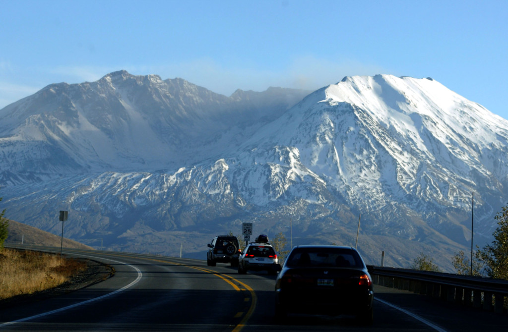 MOUNT ST. HELENS, WA – NOVEMBER 8: Cars travel toward the Clearwater Ridge visitors center on State Route 504 in view of Mount St. Helens November 8, 2004. Activity on the mountain continues as the new lava dome has grown to over 300 feet high. (Photo by Craig Mitchelldyer/Getty Images)