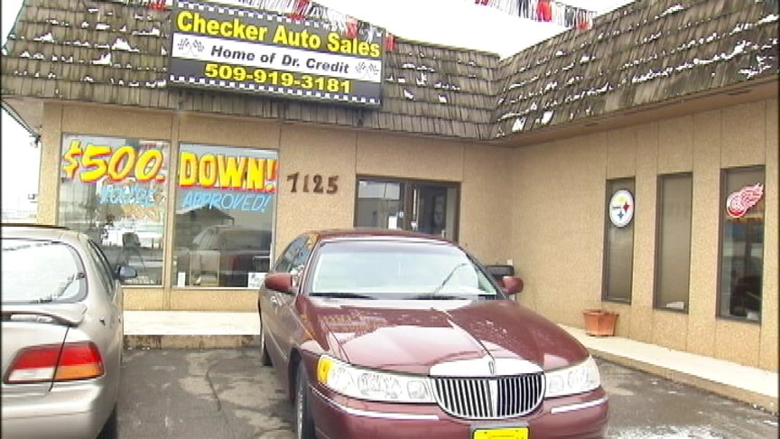 Car dealership owner surprised at police action during repossession attempt