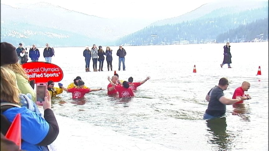 Freezin for a reason: dozens take a dip in 13th annual Special Olympics Polar Plunge