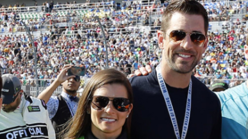 Aaron Rodgers and Danica Patrick show off some major PDA
