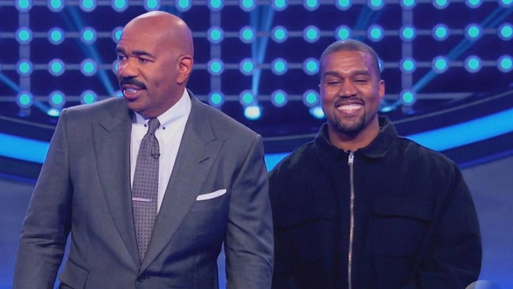Watch Kanye smile non-stop during Celebrity Family Fued
