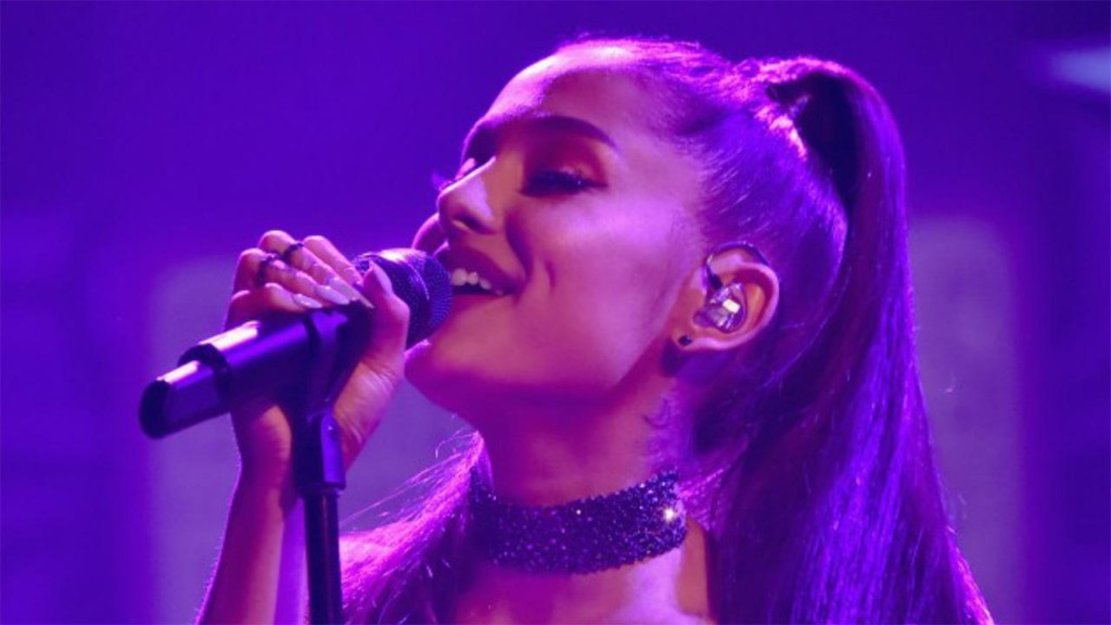 Ariana Grande flashes massive engagement ring during surprise performance
