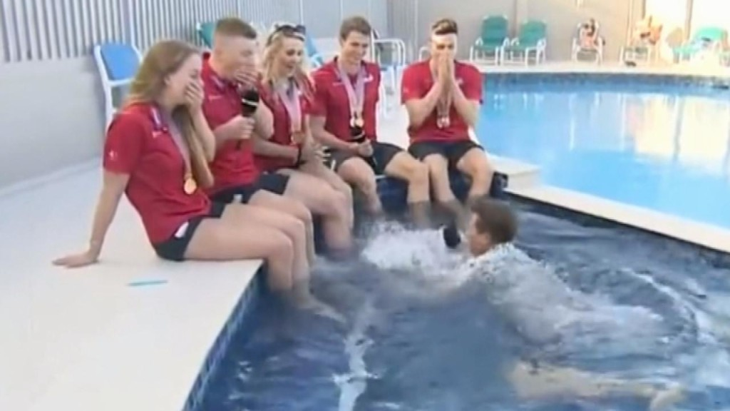 Watch sports reporter hilariously fall into pool during live interview