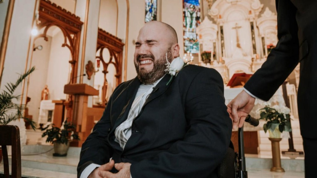 Groom in wheelchair sobs as he sees his wife at wedding