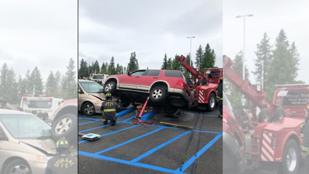 SUV drives on top of mini-van at South Hill grocery store