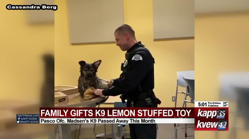Family gifts K9 Lemon stuffed toy to Pasco officer