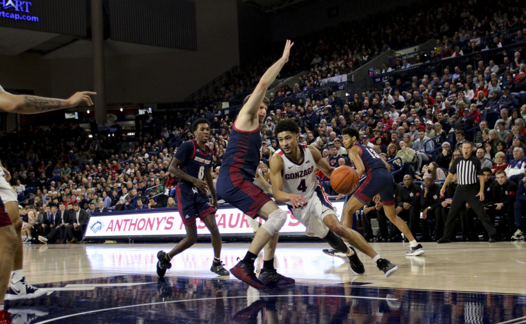 Redshirt Senior Ryan Woolridge drives to the basket against Detroit Mercy.
