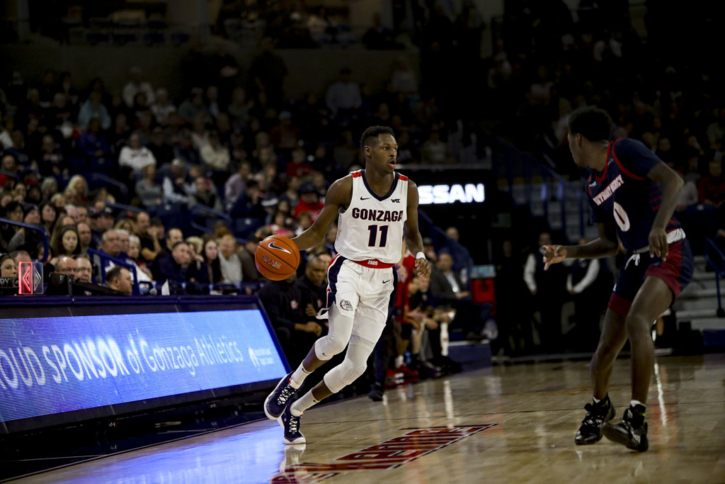 Gonzaga guard Joel Ayayi prepares to blow by a Detroit Mercy player