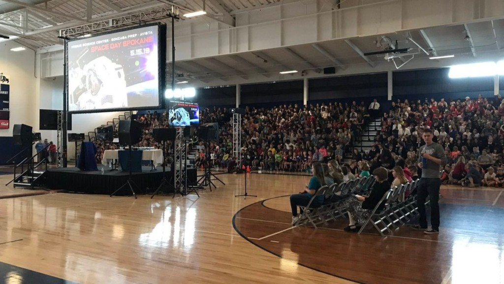 Astronaut Anne McClain speaks to local students from the International Space Station