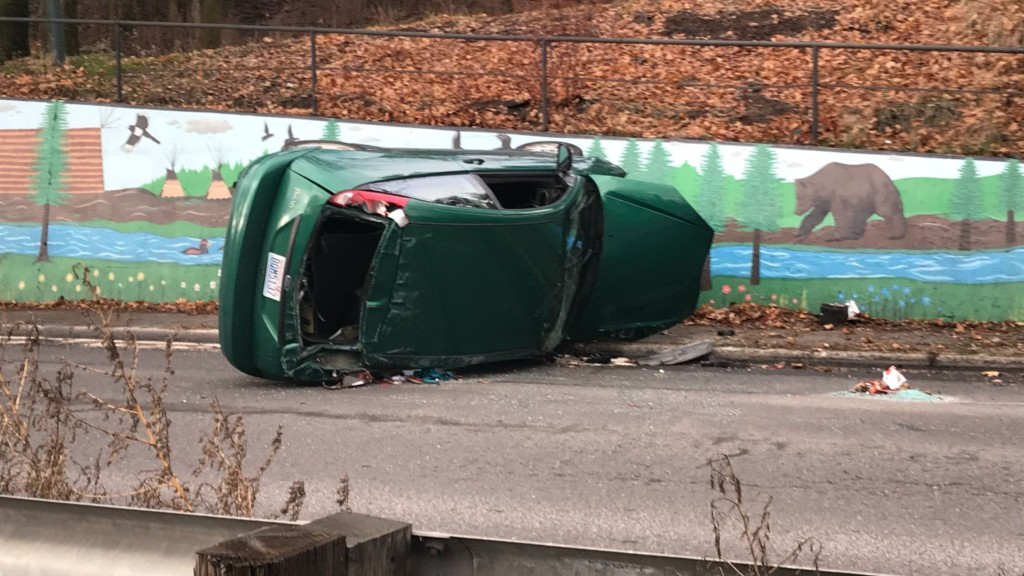 Car rolls on its side near Ash and Euclid