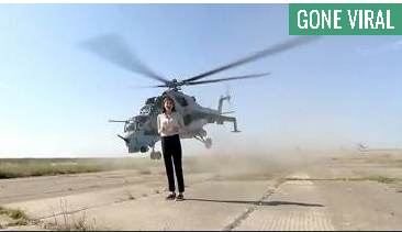 Brave journalist reports from Military helicopter runway