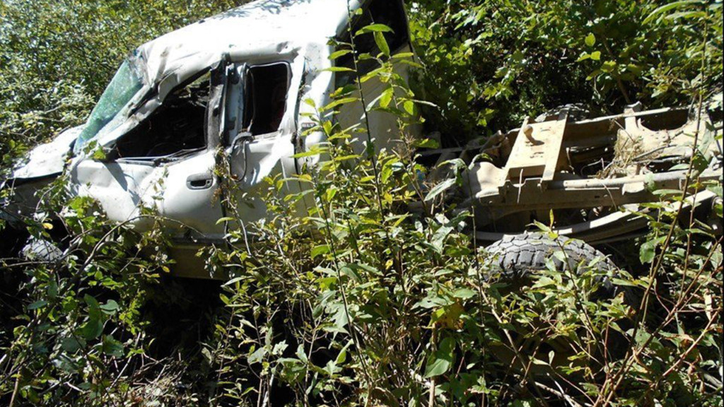 Man survives crash after truck rolls 100 yards down hill