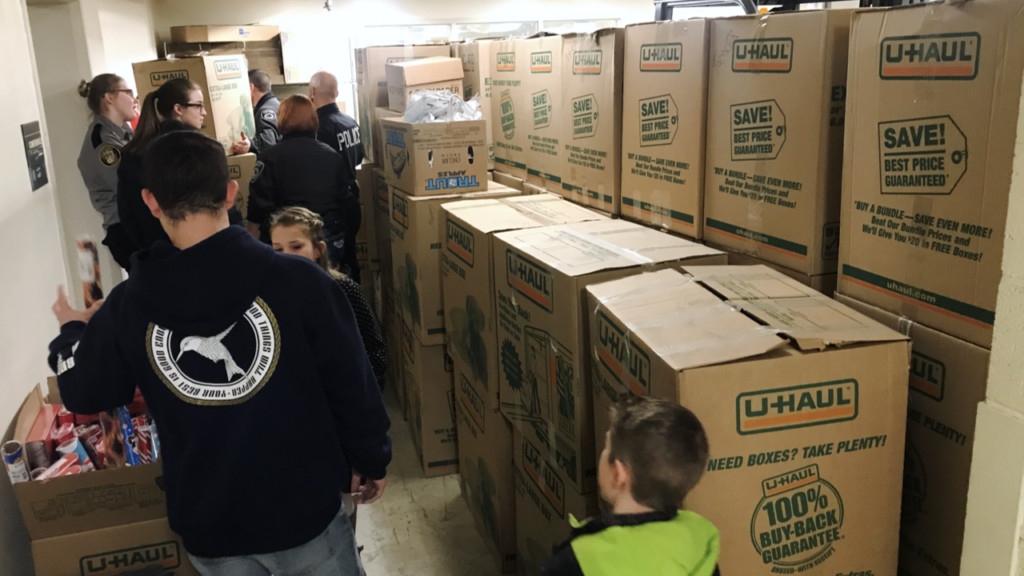 Coeur d'Alene Police Dept. fills moving truck with donated toys for sick kids