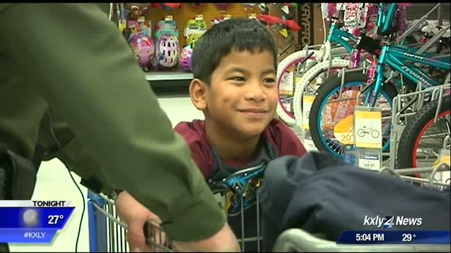 Children in need pair up with law enforcement to buy gifts for families
