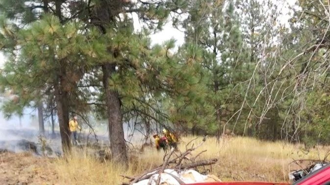 Crews mopping up half-acre fire in Spokane Valley