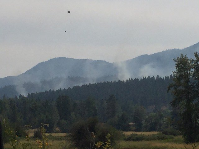 Homes briefly evacuated as fire burns near Colville