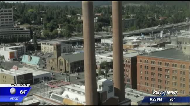 Construction on west smokestack at Spokane's Steamplant completed, work on east smokestack begins
