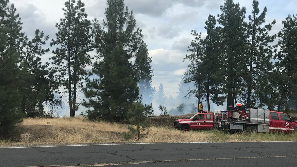 Fire burning on South Palouse Hwy near South Hill Target