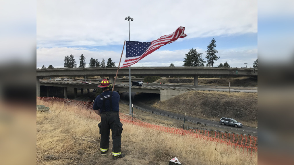 Spokane firefighter continues tradition, waves American flag in remembrance of 9/11