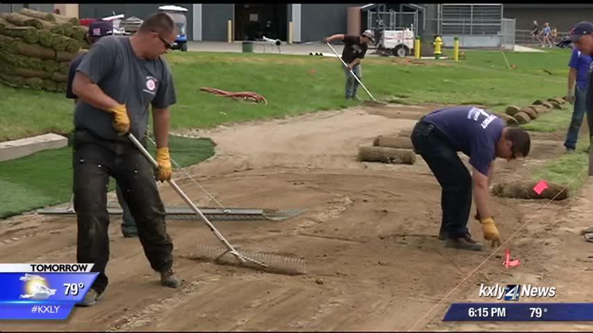 Firefighters volunteer time to make Freeman baseball field vision a reality