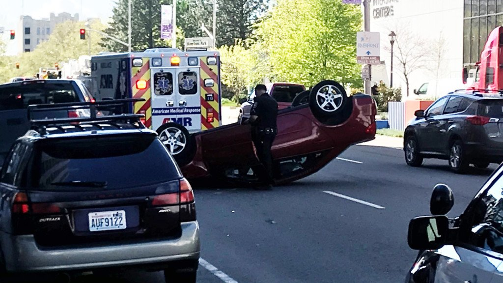 Car accident leaves vehicle upside down in Downtown Spokane