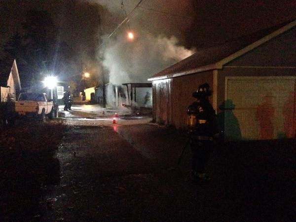 Fire crews stop garage fire from spreading to homes