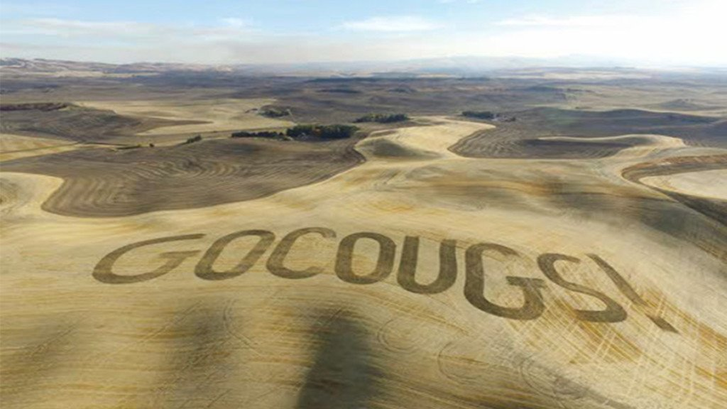 Farmer etches 'Go Cougs!' into field