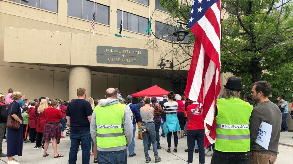 Dozens descend on Spokane City Hall for gun violence vigil