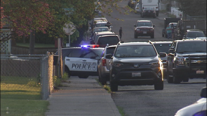 Police: Spokane man arrested for pointing gun at neighbors, officers