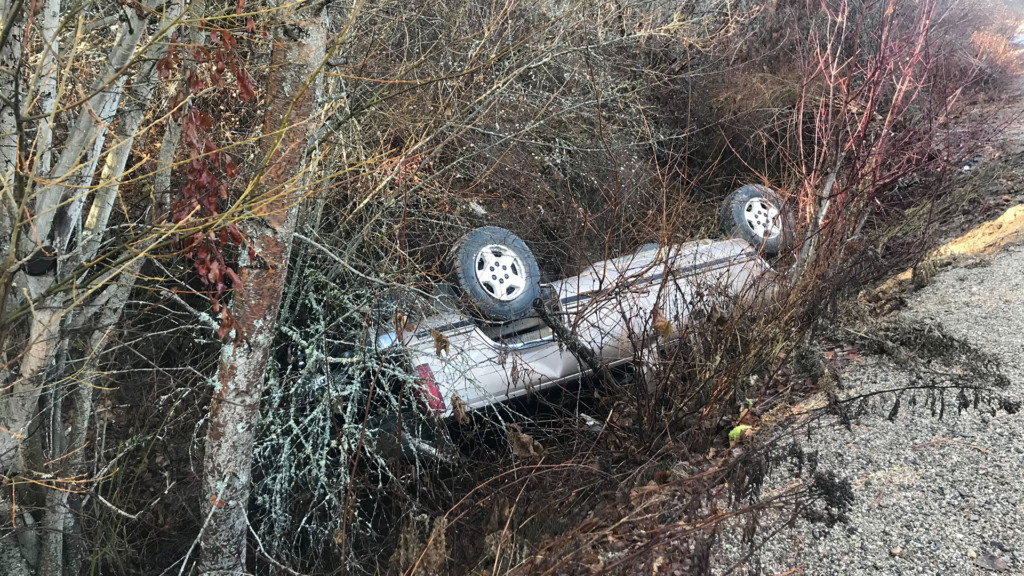 Black ice sends car tumbling upside-down into a creek, rescue crews bring driver to safety