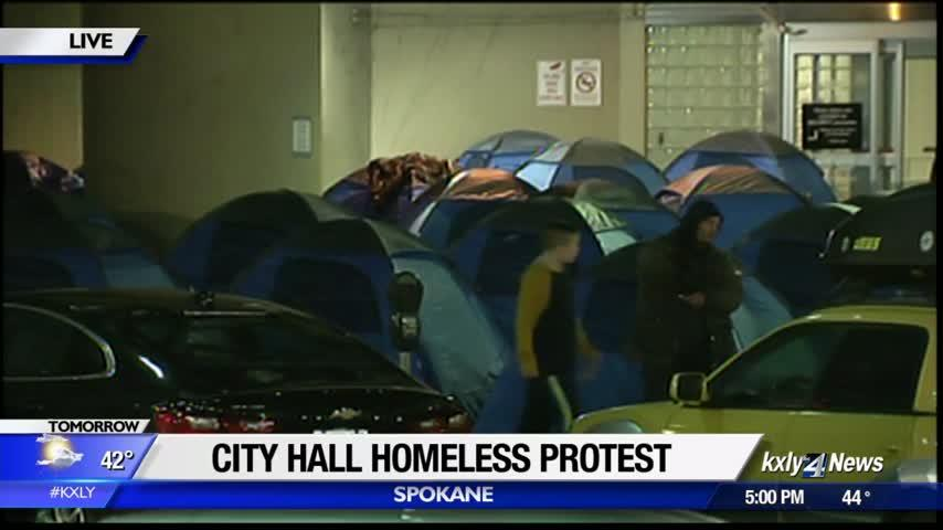 Homeless and activists protest lack of shelter space in front of City Hall