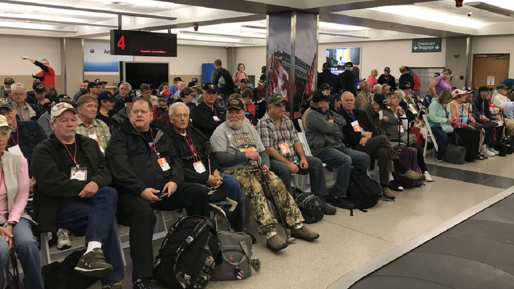 Over a hundred veterans depart Spokane International Airport on honor flight