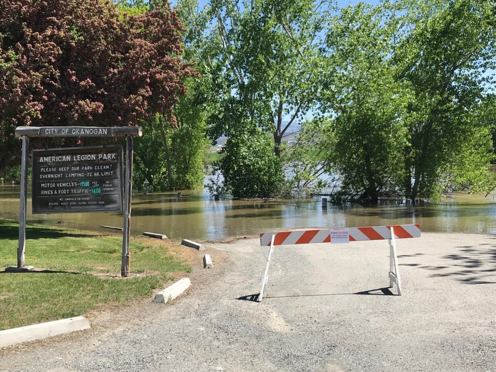 Residents in Okanogan race floodwaters to protect homes