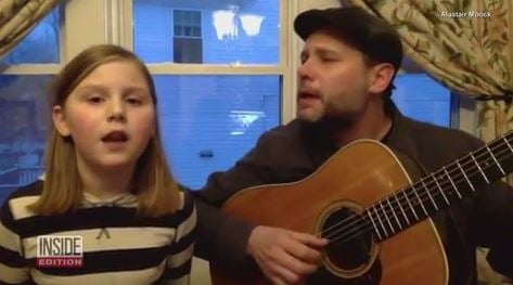 Father and daughter sing moving version of 'Lean on Me' to fight homelessness