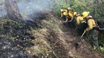 Firefighters working to contain wildfire in Liberty Lake
