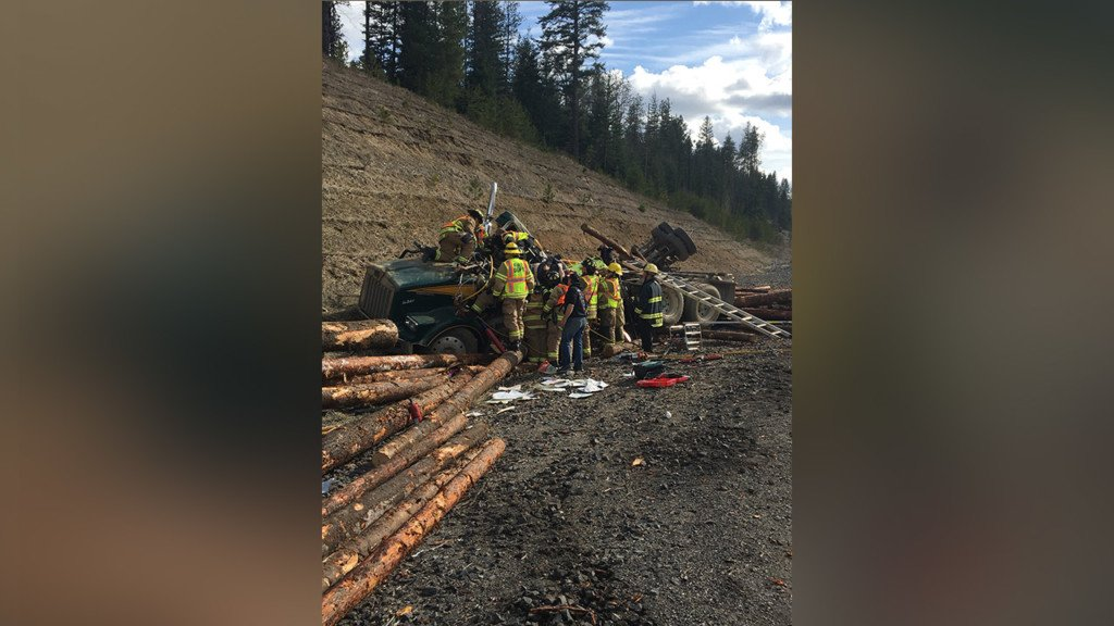 Log truck overturns on US 95, driver taken to hospital