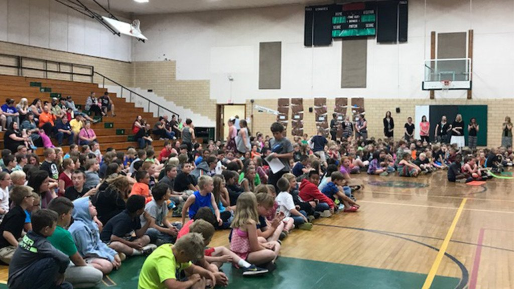 Cd'ATribe distributes books to St. Maries for Magic of Storytelling