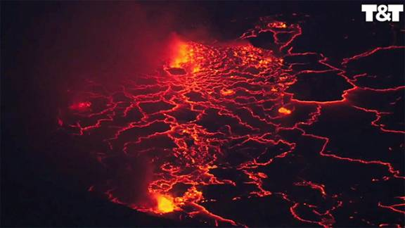 Drone flies above lake of lava