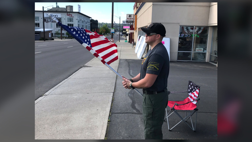Spokane man waves flag to honor the fallen on Memorial Day